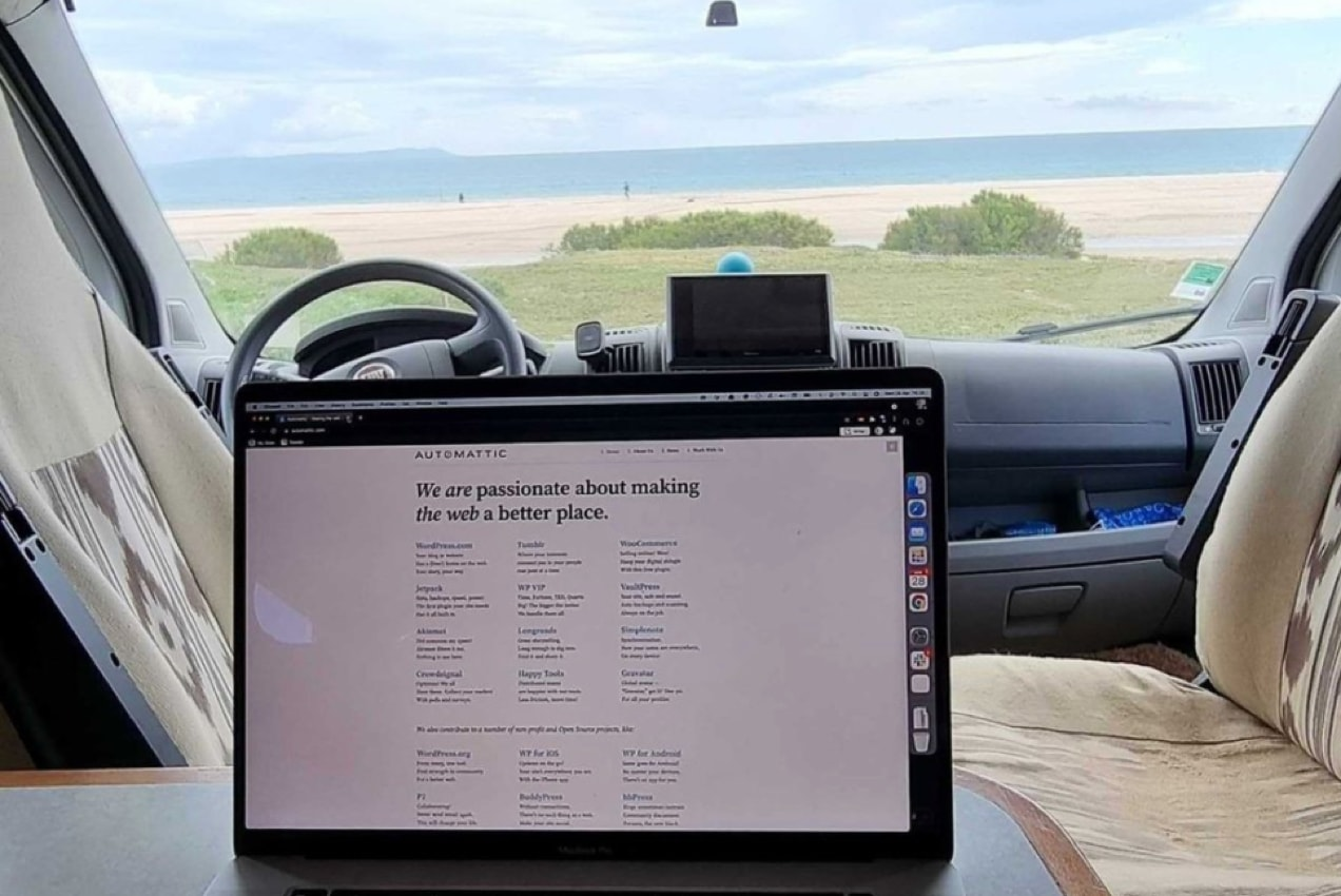 laptop in the car parked at the beach