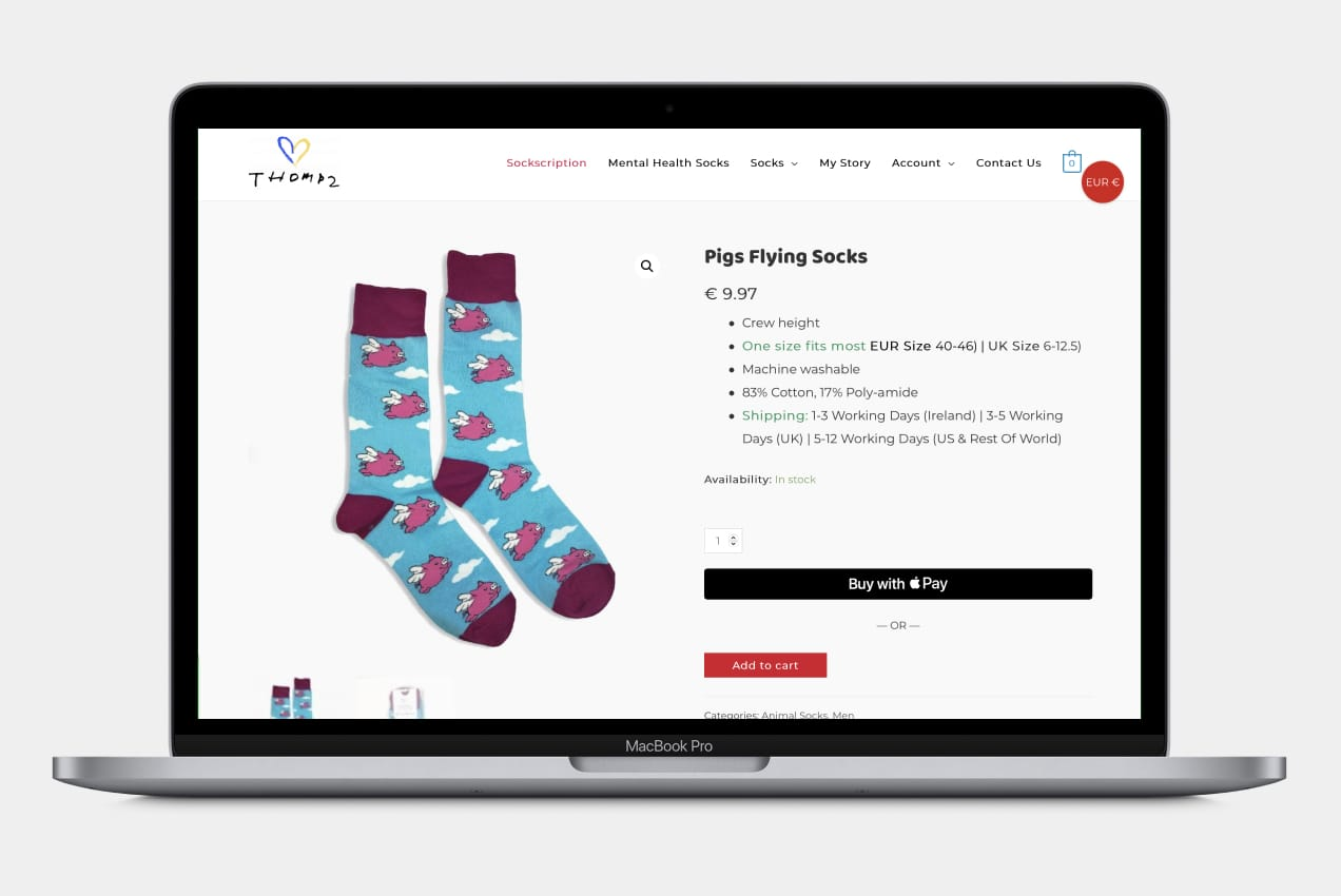 A product page for socks displayed on an Apple MacBook Pro.