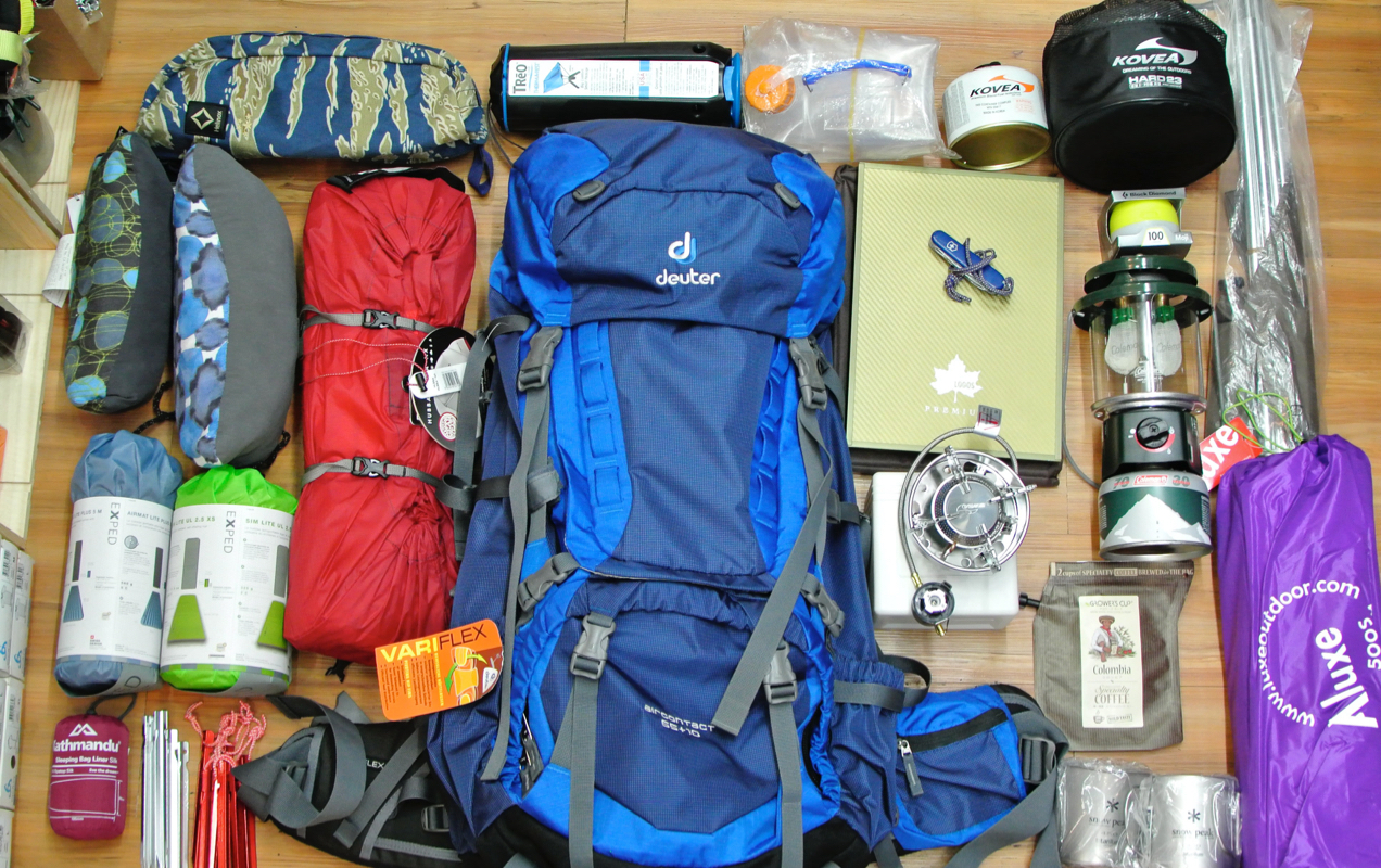 camping gear laid out on a table